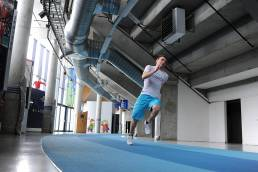 A person runs on the indoor race course